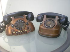 Two old copper telephones