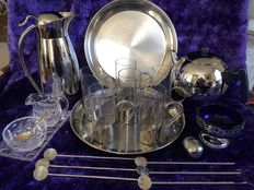 22 piece lot of stainless steel kitchen objects and crystal.