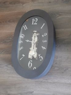Skeleton clock in black oval case with plexiglass door/dial - Frans Hermle - Late 20th century
