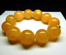 Bracelet in egg yolk colour, Baltic amber, 48 grams