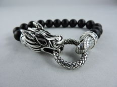 925 silver bracelet with dragon's head joined by a ring and black carved obsidian beads