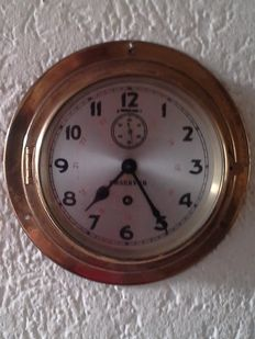 Old brass ship's clock Observer, with seconds hand.