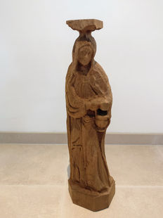 Wooden sculpture. Maria-raw freezing