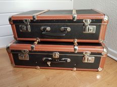 Two vintage suitcases.