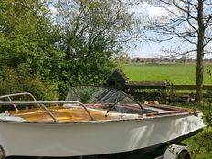 Classic wooden speedboat, complete with trailer and tarps