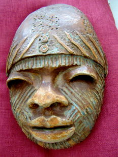 African tribal mask in terracotta