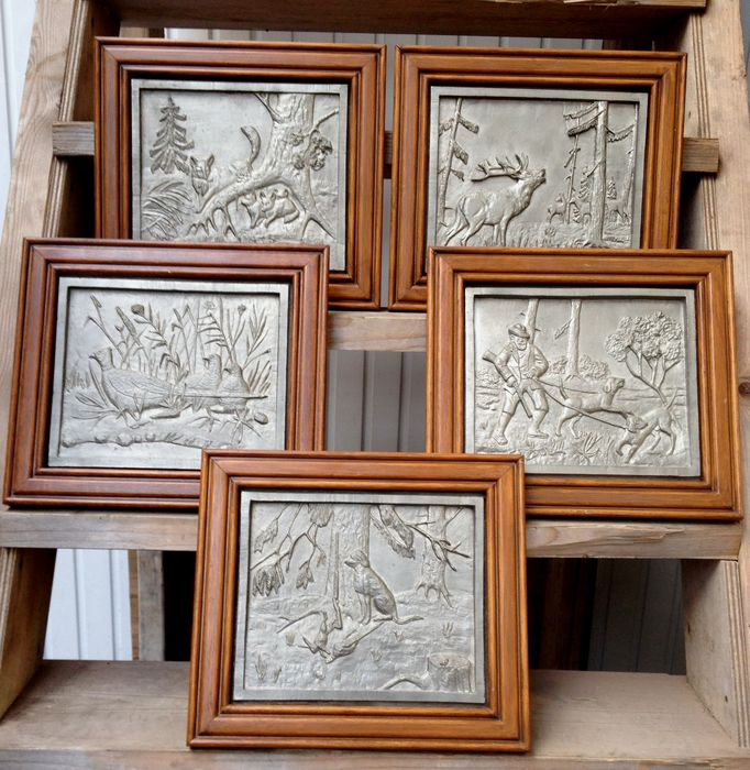 Five various framed tin hunting scenes in wooden frames