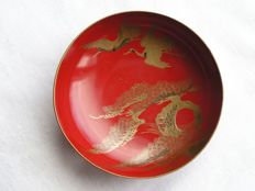 "Lacquer sake cup (""sakazuki"") with flying cranes and pine trees - Japan - early 20th century"