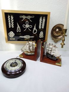 2 bookends -- ship candlestick - -sailor's knots -- barometer