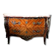 A Napoleon III gilt bronze mounted tulipwood and rosewood bombé commode - France - ca .1860/1870