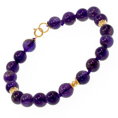 18 kt (750) yellow gold bracelet with amethysts. Length: 19.5 cm