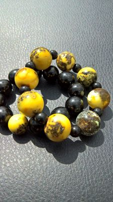 Two bracelets: 100% natural amber )+ gagat (Black amber, tears of the dragon), weight: 47.9 grams