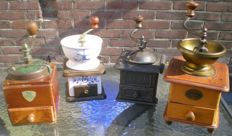 Four old wooden coffee grinders, 1940-1960