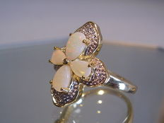 Cocktail ring with natural full opals and diamonds