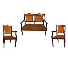 A Victorian mahogany and fruitwood marquetry three piece suite - England - late 19th century.