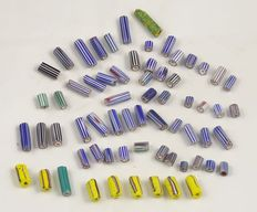 65 small pipe shaped beads; 4 layer chevron and wound glass Venetian beads