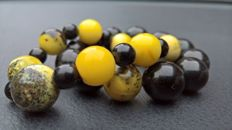 Two bracelets: 100% natural egg yolk amber+ gagat (Black amber, tears of the dragon), total weight: 44.7 grams
