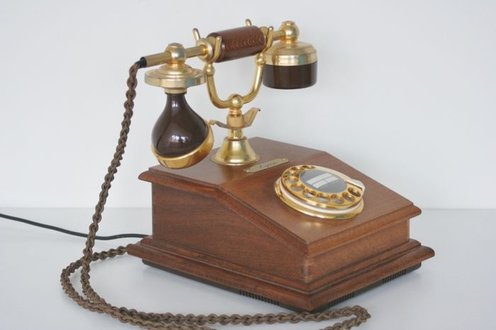 Large gold plated antique style telephone