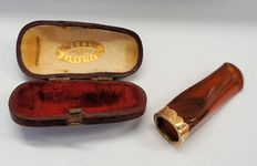Antique amber pipe with golden edge in original box, Dutch.
