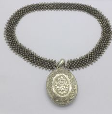 A Victorian silver locket and collarette