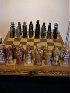 Old Asian wooden chess chest with soapstone chess pieces