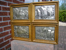 Betzner Relief - Four very fine tin embossed plaques in oak wood frames
