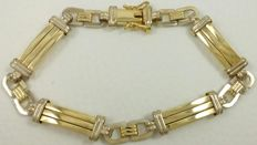 18 kt (750) white and yellow gold heavy bracelet. Weight: 17.73 g.