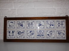 All zodiac signs on tile, together in an oak frame, nice item from the years 50/60