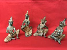 Set of 4 Buddha statues, posing as a musician in gold-plated bronze. Thailand, circa 1970