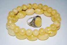 Two pressed yellow Amber bracelets  and a vintage silver Amber ring