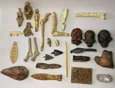 Collection of replicas of fossils, tools, amulets, arrows and prehistoric sculptures