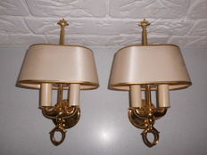Two identical brass wall-lamps with a classic look, each with 2 lights, special shade and pull cord, luxurious appearance
