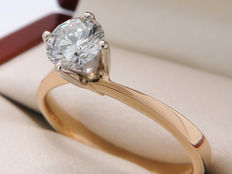 Bicolour gold, diamond ring with a solitaire diamond of 0.52 ct.