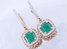 Earrings in bicolour gold set with 2 intense green Colombian emeralds 1.40 ct in total & 56 brilliant cut diamonds, 0.50 ct in total - length: 3 cm