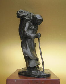 In the style of Paul d'Aire - bronze sculpture of an old woman with stick and a bundle of sticks in basket - ca 1900