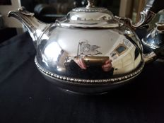 Silver plated tea pot engraved with the flag of the White Star Line shipping company.