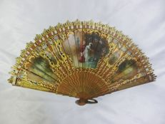 A carved, openworked and hand painted brise hand fan, Spain, circa 1900