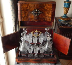 A Napoleon III cave liqueur - with brass and mother-of-pearl inlays - with crystal set made of 4 bottles and 16 glasses - France - ca. 1880
