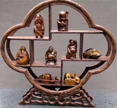 Display stand with 8 boxwood netsuke – Japan – Second half of the 20th century