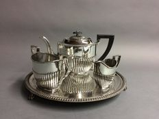 Silver plated tea set on a round serving tray, England, ca 1925