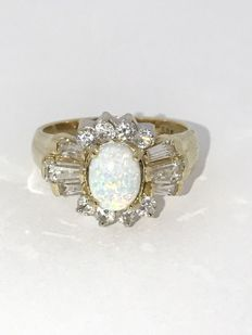 14 karat yellow gold ring with opal and white zirconia. Ring size 17 3/4