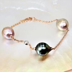 750 gold station bracelet with Tahiti cultured pearl and freshwater cultured BQ pearls measuring 12 X 13 mm in diameter, and with a diamond of 0.02 ct.