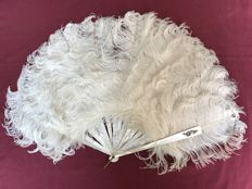 A mother of pearl and ostrich feather fan, France, circa 1900