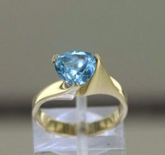 Solid 14 kt (585/1000) gold ring with blue topazes - size 52.