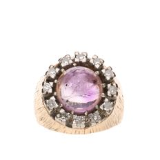 Rose gold ring set with a purple precious stone and 12 brilliant cut diamonds of approx. 0.02 ct each and in total: 0.24 ct – Inside measurement: 16.25 mm