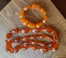 Set of vintage Baltic Amber cognac necklace with carved beads & butterscotch bracelet. 74.2 gram and 32.1 grams