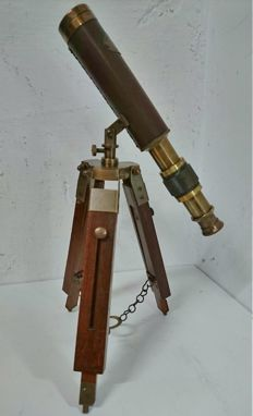 Brass binoculars on tripod, partly wood and brass