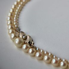 Antique necklace with genuine salt water round Japanese Akoya pearls with nice reflections.
