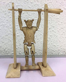 A bone 'somersault toy', early 20th century