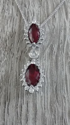 Pendent with natural red rubies and diamonds.